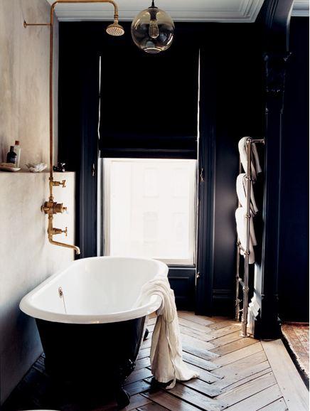 melanie acevedo dark bathroom stand alone tub